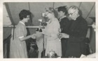 Image 18 of 23 : 1959 Helen Wright receiving the Hitchem Music Cup from Archbishop Selwyn Bean with Miss Robinson, Head Mistress, to his right